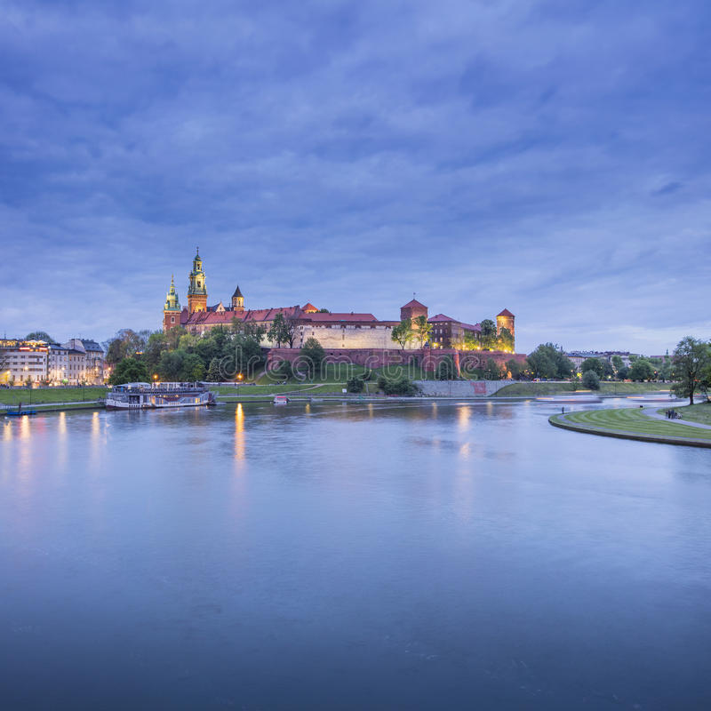 Blue twilights above the old castle in Krakow stock image