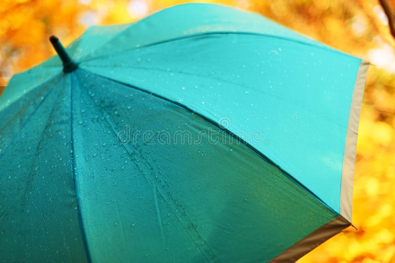 Blue umbrella with rain drops. Autumn weather concept.  stock photography