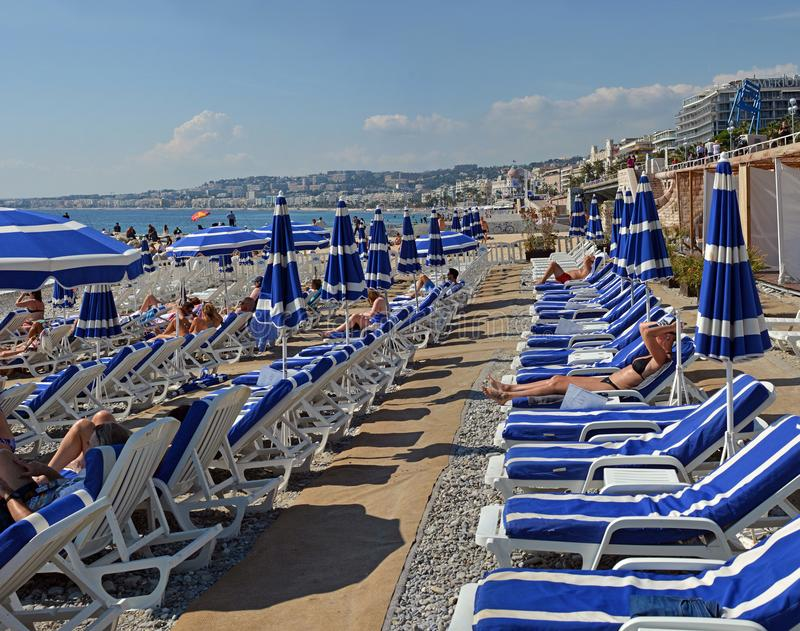 Blue Umbrellas on the Beach at Nice France stock images
