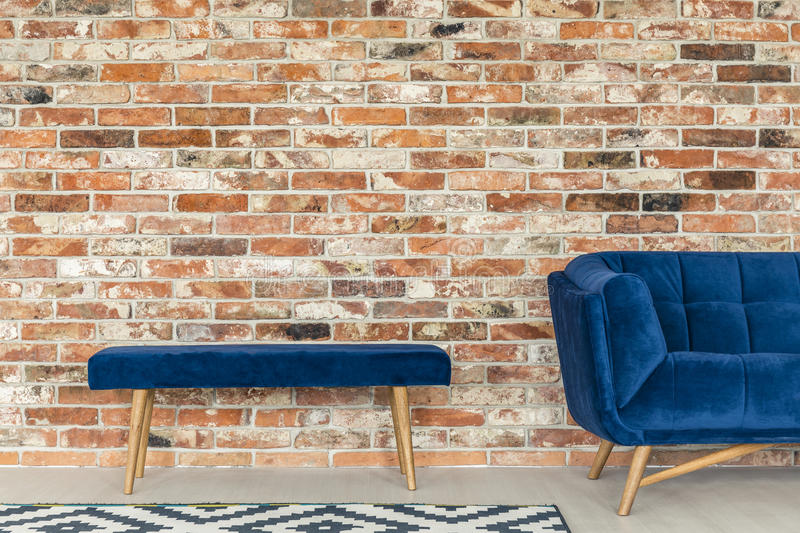 Blue upholstered bench royalty free stock photo