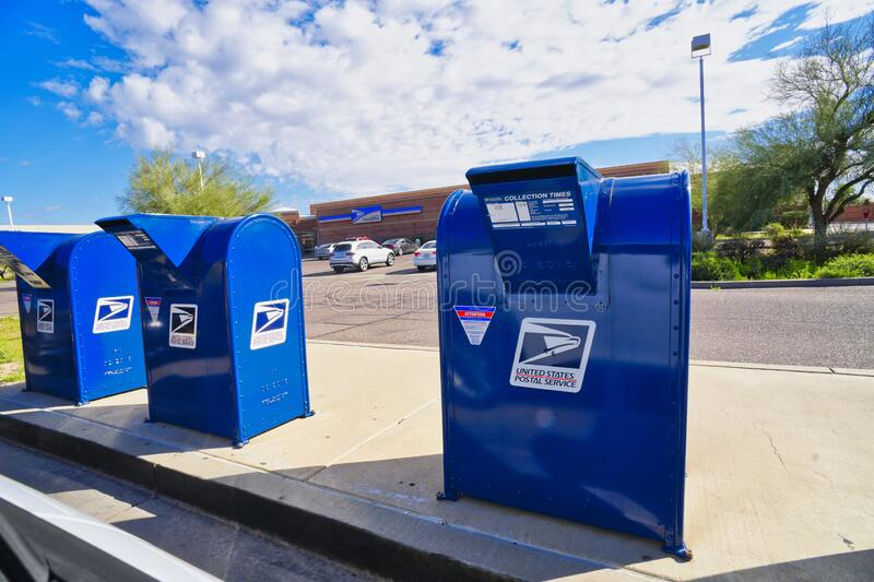 USPS Mailboxes in front of a Post Office branch stock photo
