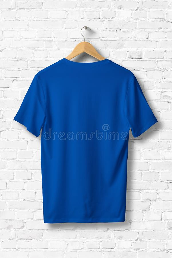 Blue V-Neck Shirt Mock-up hanging on white wall. royalty free illustration