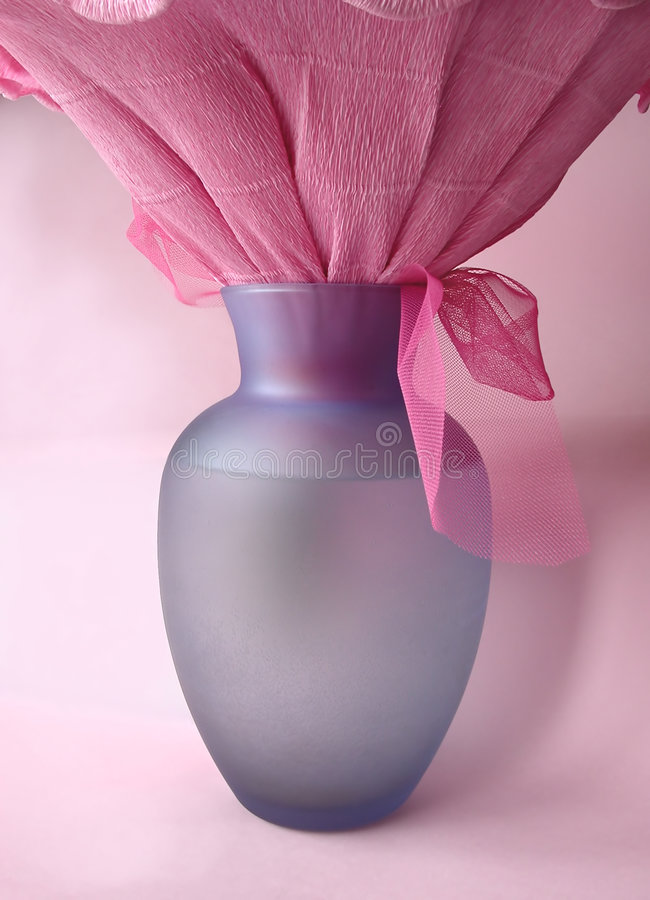 Blue vase in rose stock photos