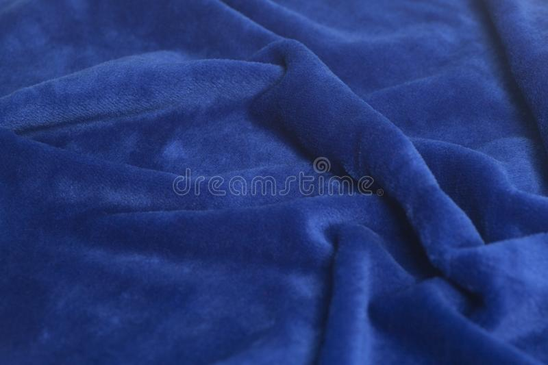 Blue velvet fabric background stock photo