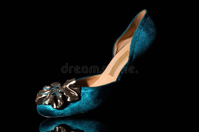 Blue velvet shoes. Fancy shoes dramatic light against black background royalty free stock photo