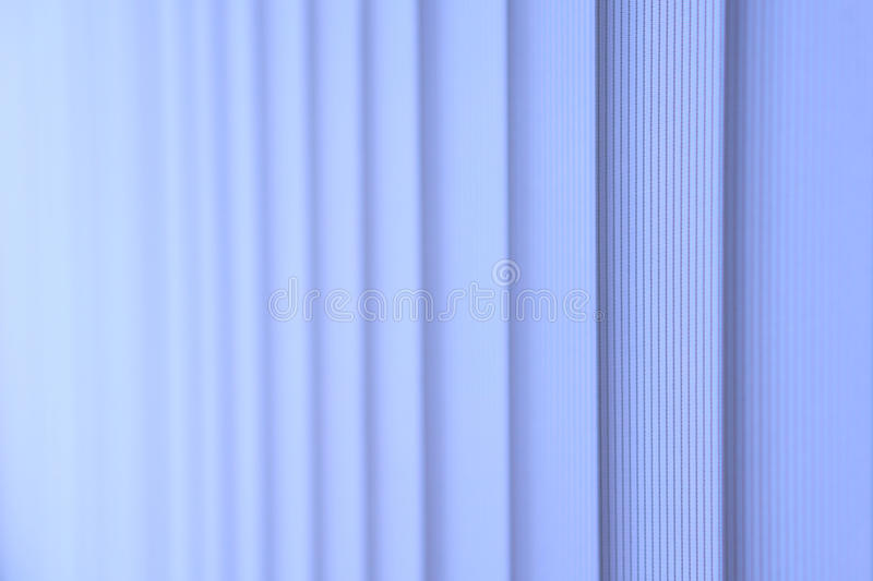 Blue vertical blinds. royalty free stock image