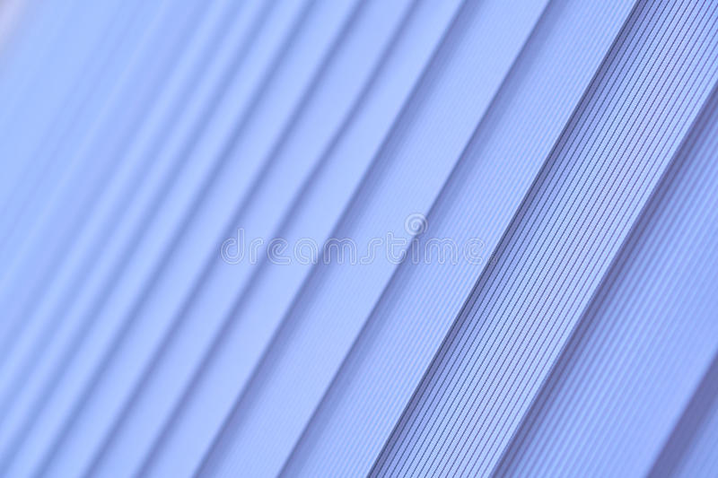 Blue vertical blinds. Soft selective focus. royalty free stock photography