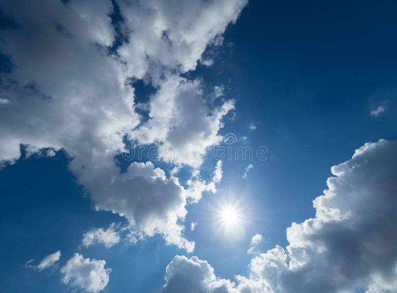 Blue and very cloudy sky on a sunny day stock images