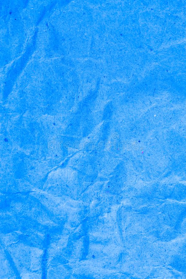 Blue vignette crumpled paper. Abstract, ancient, backdrop, background, blank, card, cardboard, color, crease, creased, damaged, design, detail, dirty, effect stock photos