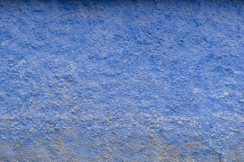 Blue vintage background. Old plaster on the facade of the house. Close, closeup, wall, glass, stone, design, detail, material, surface, clean, clear, concrete royalty free stock photo