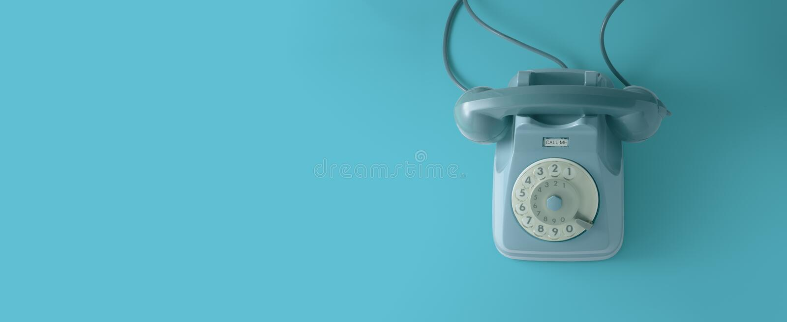 A vintage dial telephone with blue background.A blue vintage dial telephone with blue background. A blue vintage dial telephone with blue background stock photo