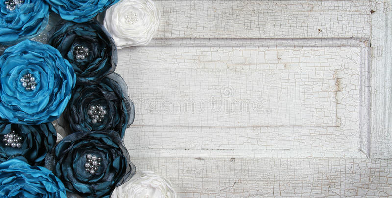 Blue vintage flowers on an old door royalty free stock photo