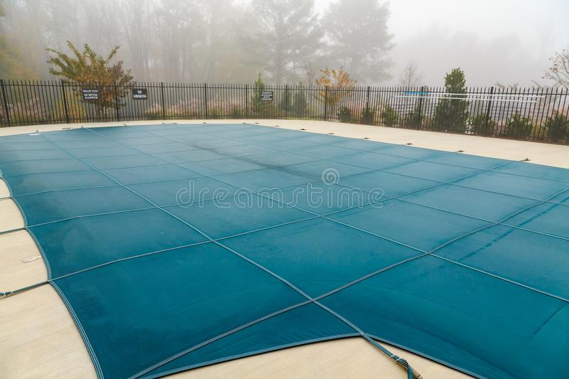 Pool Cover in Fog. A Blue Vinyl Pool Cover in Fog royalty free stock image
