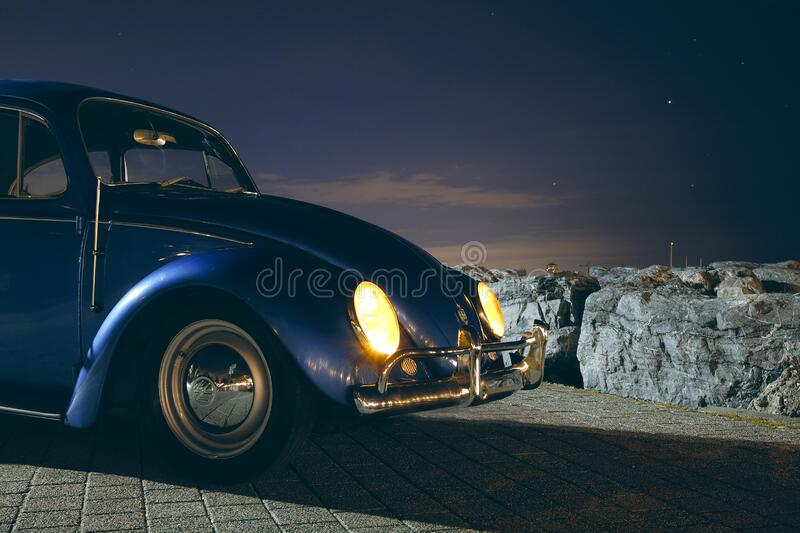 Blue Volkswagen Beetle Car Near Cliff during Night Time stock photos