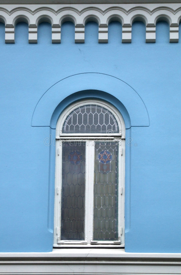 Blue wall and a beautiful window royalty free stock images