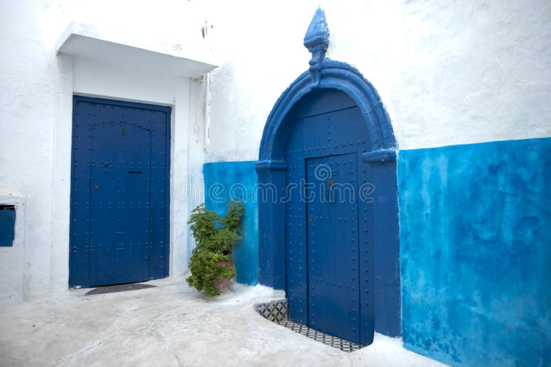 Blue painted doors and walls in Kasbah of the Udayas, Rabat, Morocco stock images