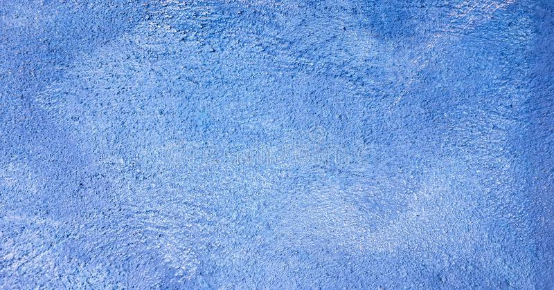 Blue washed painted textured abstract background with brush strokes in white and blue shades. Abstract light painting art backgrou stock photo