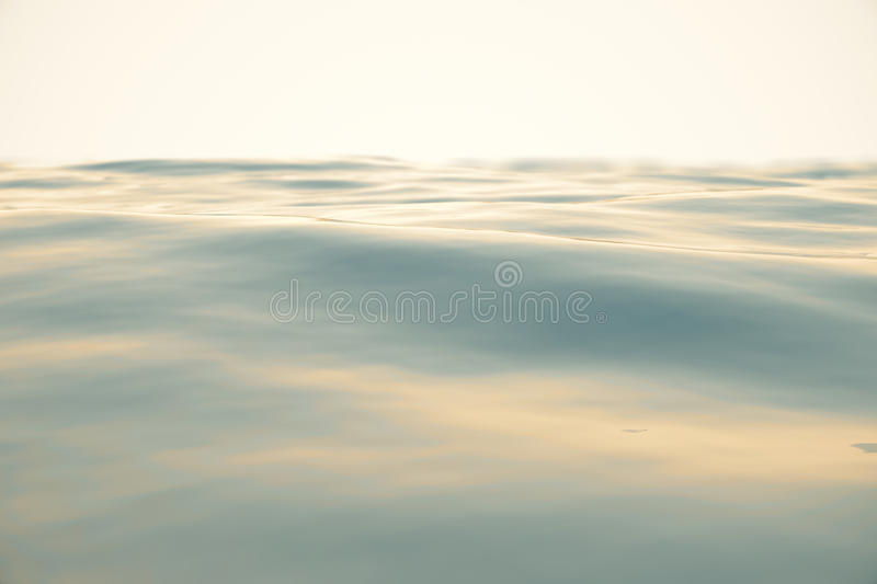 Blue water background with ripples, sea, ocean wave low angle view. Close-up Nature background. Hard focus with. Selective focus, 3d rendering stock illustration