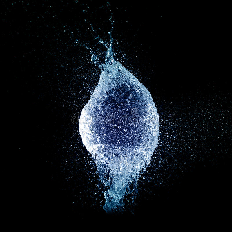 Blue water ballon explosion stock image