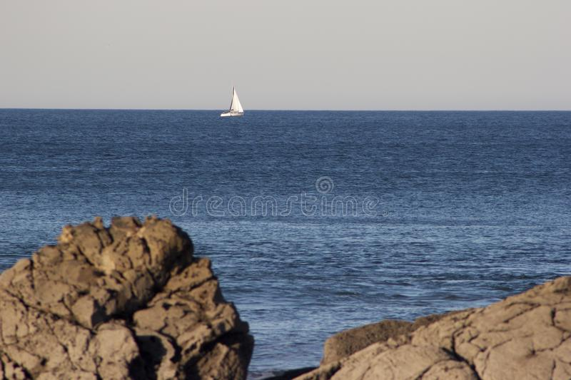 Blue water in a calm day stock photography
