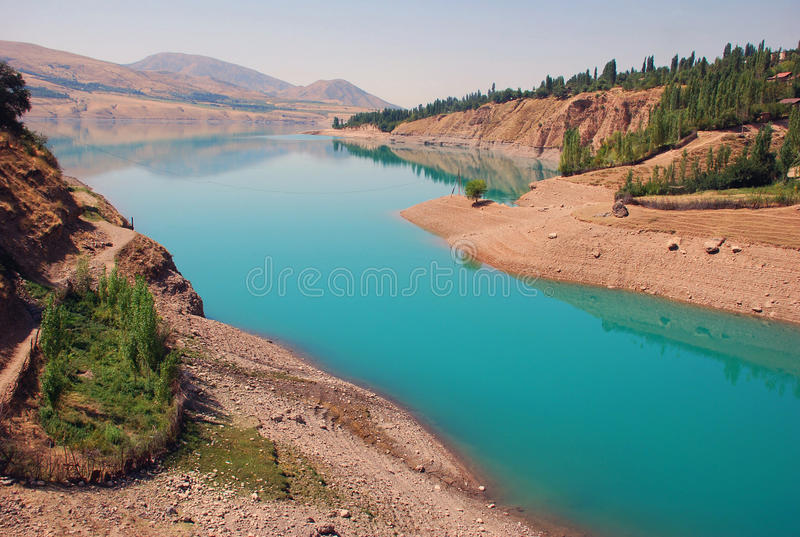 Blue water in the Charvak water reservoir royalty free stock photography
