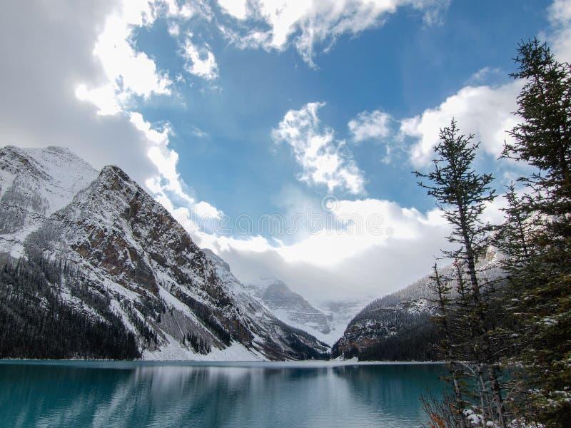 Lake Louise Alberta in winter. Blue water and cloudy skies in Lake Louise, Alberta, Canada stock photos