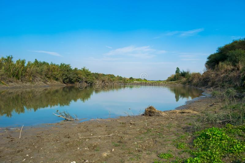 Blue water lake in ajungle royalty free stock photos