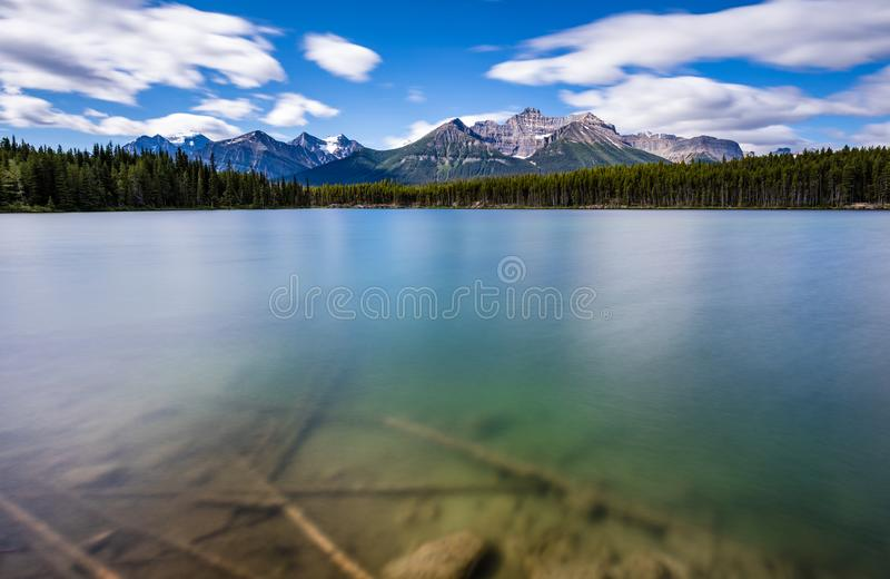 Blue water lake with mountains stock photography