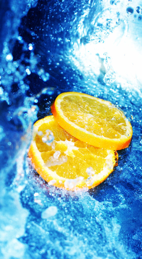 Blue water with oranges royalty free stock photos