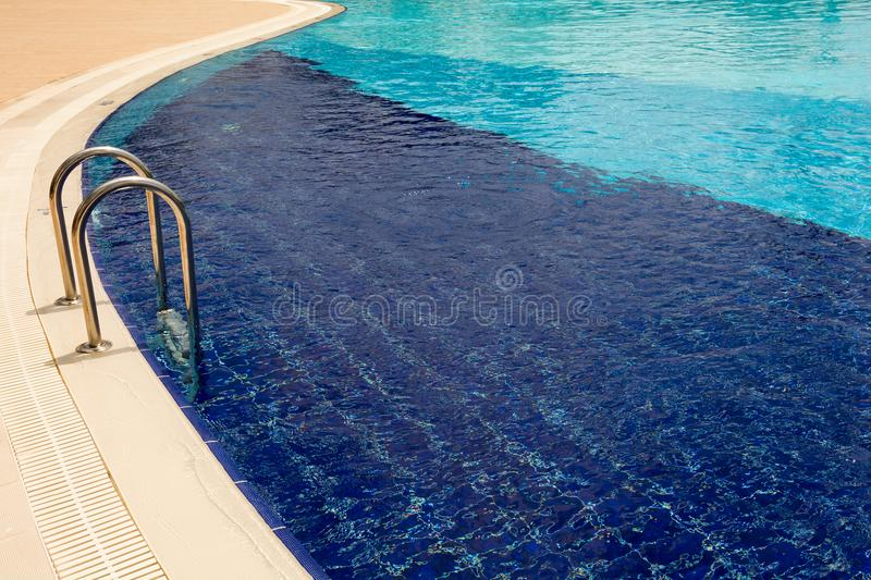 Blue water in the swimming pool.  royalty free stock photo