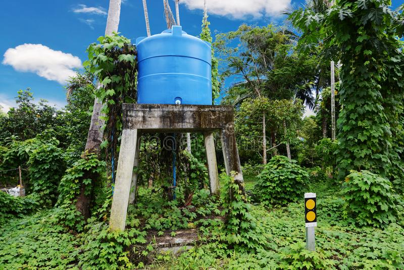 Blue water tank on the tower. stock images