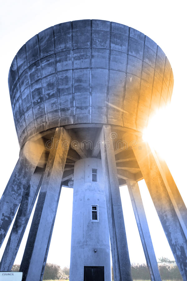 Blue water tower. A water tower in the irish countryside on a hot day royalty free stock photos