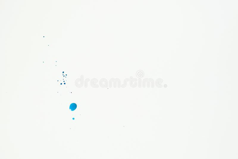 Blue watercolor paint blots on white parer as background. Free space for text. Abstract blue watercolor hand paint texture on white background. Drop the blue royalty free stock images
