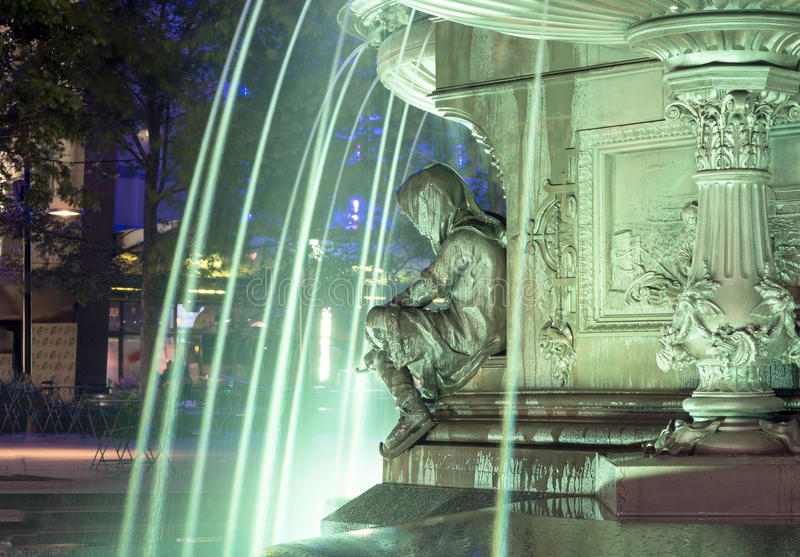 Blue waters. Cincinnati's famous Fountain Square on a late Spring night. This is the heart of the Queen City where folks go to celebrate royalty free stock image