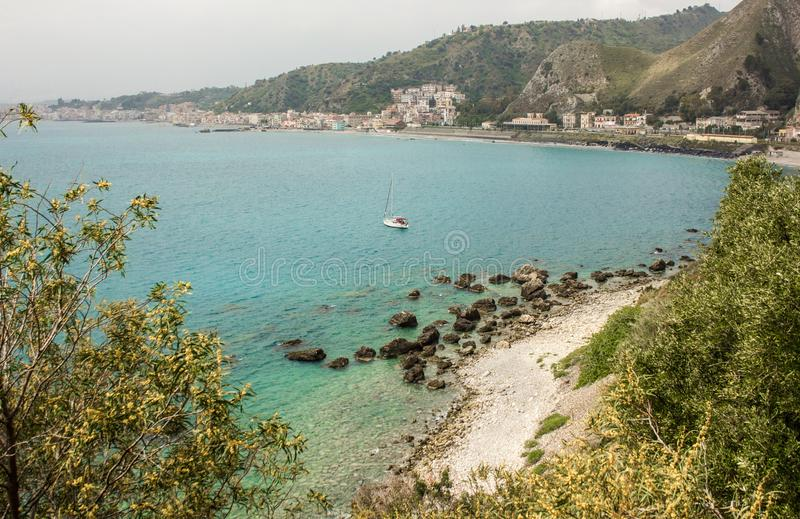 Blue waters of the Mediterranean beach on the coast of Taormina royalty free stock photography