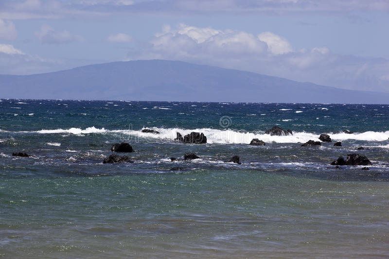 Blue waters off the coast of Maui. Blue ocean waters off the coast of Maui looking towards Lanai in the distance stock photo