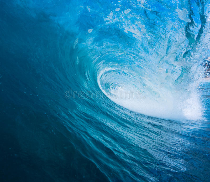 Blue Wave. Large Blue Surfing Wave Breaks in Ocean stock photography