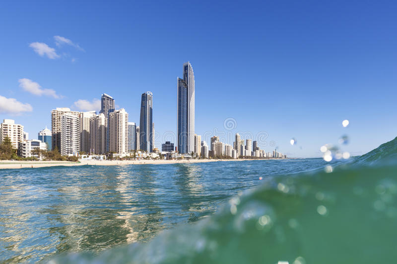 Blue waves rolling on Surfers Paradise beach stock photos