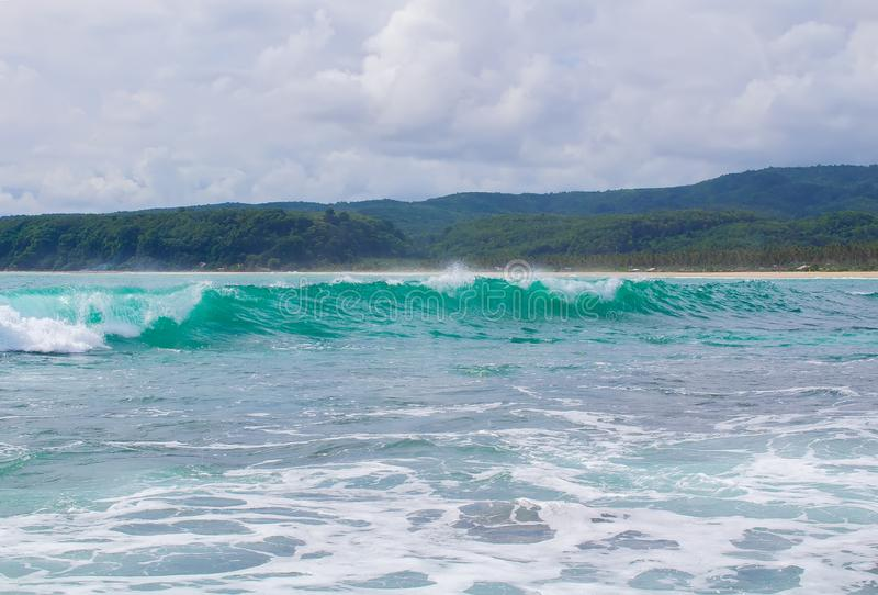 Blue Wave at Sawarna Beach in Indonesia royalty free stock photography