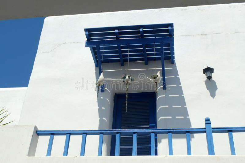 BLUE AND WHITE BALCONY AS MEDITERRANEAN STYLE IN SANTORINI PARK, THAILAND. Blue and white balcony as Mediterranean style decor. The photo was taken in Santorini stock photo
