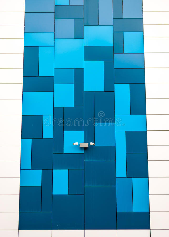 Blue and White Building. Modern style blue and white building with a security camera stock image