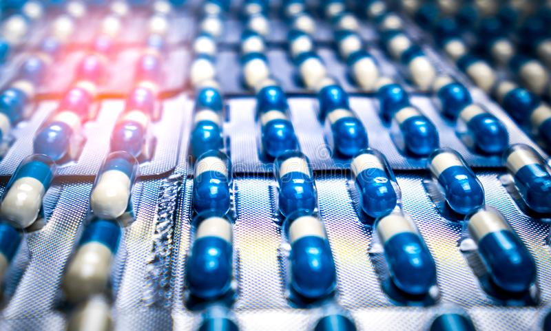 Blue and white capsules pill in blister pack arranged with beautiful pattern. Global healthcare concept. Antibiotics drug. Resistance. Antimicrobial capsule stock photo