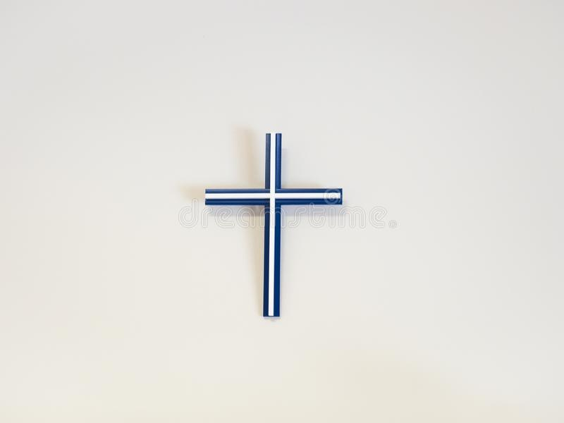 Blue and white catholic cross. On a wall stock image