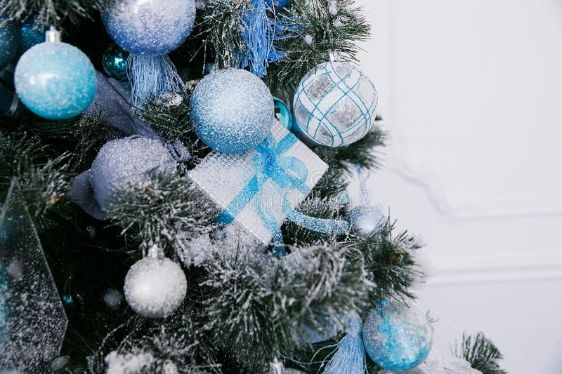 Blue and white Christmas decorations on the New Year tree in the home interior. On the eve of the holiday stock photos