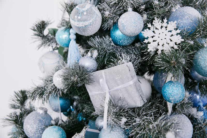 Blue and white Christmas decorations on the New Year tree in the home interior. On the eve of the holiday royalty free stock photo