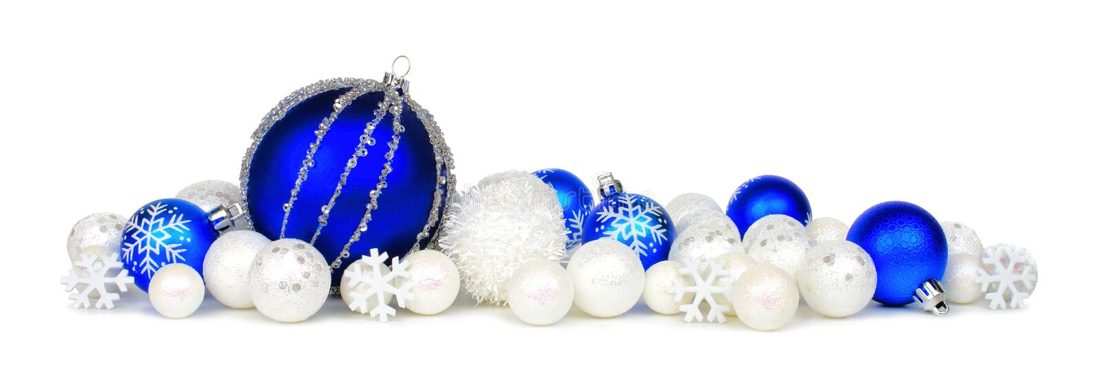 Blue and white Christmas ornament border. Christmas border of blue and white ornaments over a white background royalty free stock photos