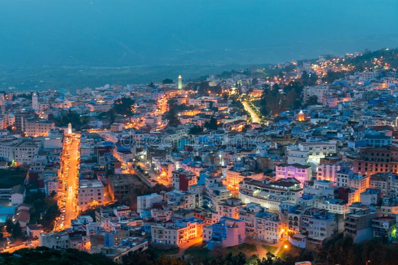 Blue and White Colored Homes and Buildings in Chefchaouen Morocco at Night. A nighttime long exposure image of blue and white colored buildings with streets in royalty free stock image
