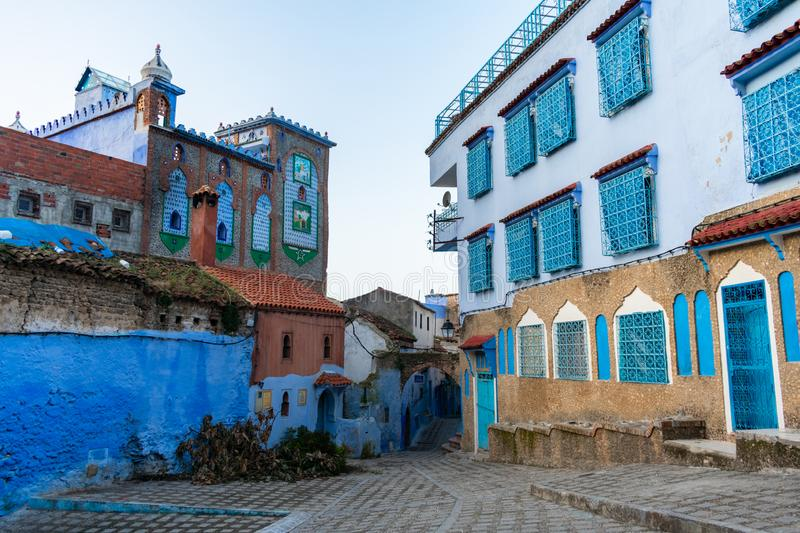 Blue and White Colored Homes and Buildings in Chefchaouen Morocco. A residential square with blue and white colored homes and buildings in the blue city of stock images