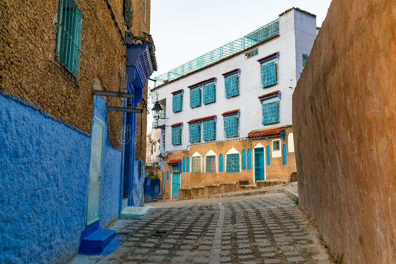 Blue and White Colored Homes and Buildings in Chefchaouen Morocco. A residential street with blue and white colored homes and buildings in the blue city of stock photo
