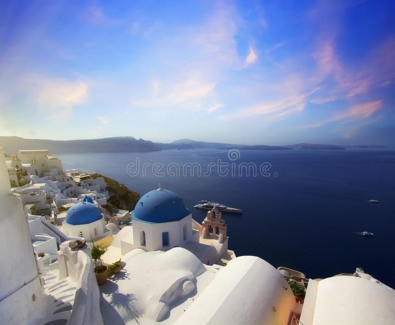 Blue and white colours of Oia City. Magnificent panorama of the island of Santorini Greece during a beautiful sunset in the Medite royalty free stock images